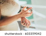 hands of the bride with perfume | Shutterstock . vector #603359042