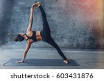woman practicing yoga in a... | Shutterstock . vector #603431876