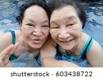 senior woman in the pool | Shutterstock . vector #603438722