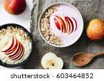 bowl of oatmeal porridge with... | Shutterstock . vector #603464852