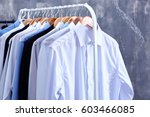 rack of clean clothes hanging... | Shutterstock . vector #603466085