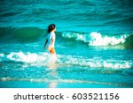 little girl in the sea | Shutterstock . vector #603521156