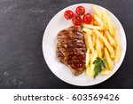 plate of grilled meat with... | Shutterstock . vector #603569426