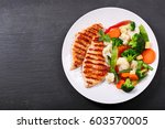 plate of grilled chicken with... | Shutterstock . vector #603570005