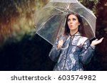 Surprised Woman In Raincoat...