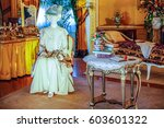 """Small photo of ASHEVILLE, NORTH CAROLINA - MARCH 4, 2017: Biltmore's costume exhibition. The """"House of Mirth"""" is featured in Mrs Vanderbilt's bedroom. Costumes were arranged with mirrors to see the backs of both."""