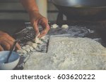 making dough by female hands    ... | Shutterstock . vector #603620222