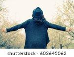 outdoor portrait of 40 years... | Shutterstock . vector #603645062