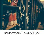 ski and snowboard boots exposed ... | Shutterstock . vector #603774122