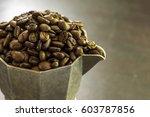 roasted coffee beans in moka pot | Shutterstock . vector #603787856