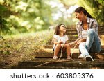 mother and daughter playing... | Shutterstock . vector #603805376