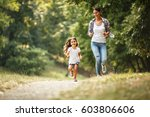 mother and daughter playing and ... | Shutterstock . vector #603806606