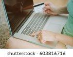 woman hands holding credit card ...   Shutterstock . vector #603816716