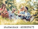 happy young friends having... | Shutterstock . vector #603839675