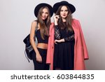 studio   fashion image of two ... | Shutterstock . vector #603844835