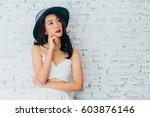 young woman thinking about... | Shutterstock . vector #603876146