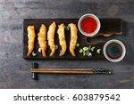 fried tempura shrimps on... | Shutterstock . vector #603879542