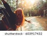woman driving a car traveling...   Shutterstock . vector #603917432