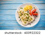 fish dish   fried cod  | Shutterstock . vector #603922322