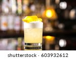closeup glass of whiskey sour... | Shutterstock . vector #603932612