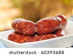 a plate with string of chorizos typical of Spain - stock photo