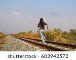 woman running on railway  run...
