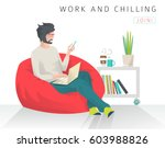 young man sits on bean bag with ... | Shutterstock .eps vector #603988826