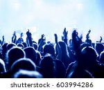 cheering crowd at a rock concert | Shutterstock . vector #603994286