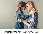 cute little girl and her... | Shutterstock . vector #603997262