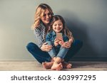 cute little girl and her... | Shutterstock . vector #603997295