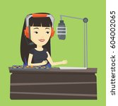 asian female radio dj in... | Shutterstock .eps vector #604002065