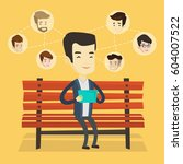 young man sitting on a bench... | Shutterstock .eps vector #604007522