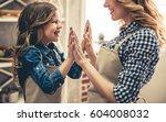 cute little girl and her... | Shutterstock . vector #604008032
