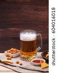 glass of beer. nachos chips....   Shutterstock . vector #604016018
