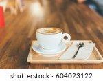 coffee cup latte art | Shutterstock . vector #604023122