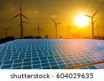 solar panels with wind turbines ... | Shutterstock . vector #604029635