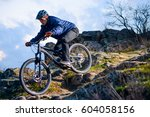 cyclist riding the bike on the... | Shutterstock . vector #604058156