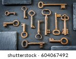 old  rusty keys on the stone... | Shutterstock . vector #604067492