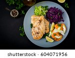 chicken breast cooked on a... | Shutterstock . vector #604071956