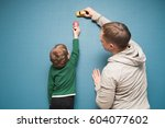 father and son are playing with ... | Shutterstock . vector #604077602