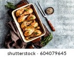baked chicken drumsticks on a... | Shutterstock . vector #604079645