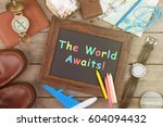 the world awaits inscription on ... | Shutterstock . vector #604094432