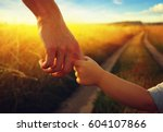 hands of the parent and litlle... | Shutterstock . vector #604107866