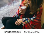 girl drinks hot chocolate from... | Shutterstock . vector #604122242