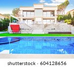 luxurious villa with a swimming ... | Shutterstock . vector #604128656