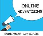 hand holding megaphone.... | Shutterstock .eps vector #604160936