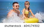 happy father with daughter... | Shutterstock . vector #604174502