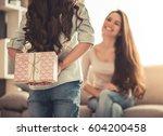 charming little girl is giving... | Shutterstock . vector #604200458