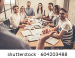 successful young business... | Shutterstock . vector #604203488