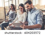 young people are sitting in a... | Shutterstock . vector #604203572